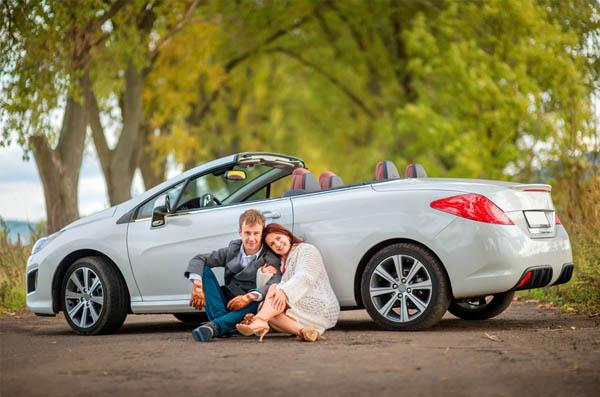happy couple near the car